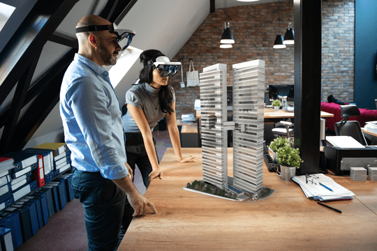 Male and Female Architects Work with Holographic Augmented Reality